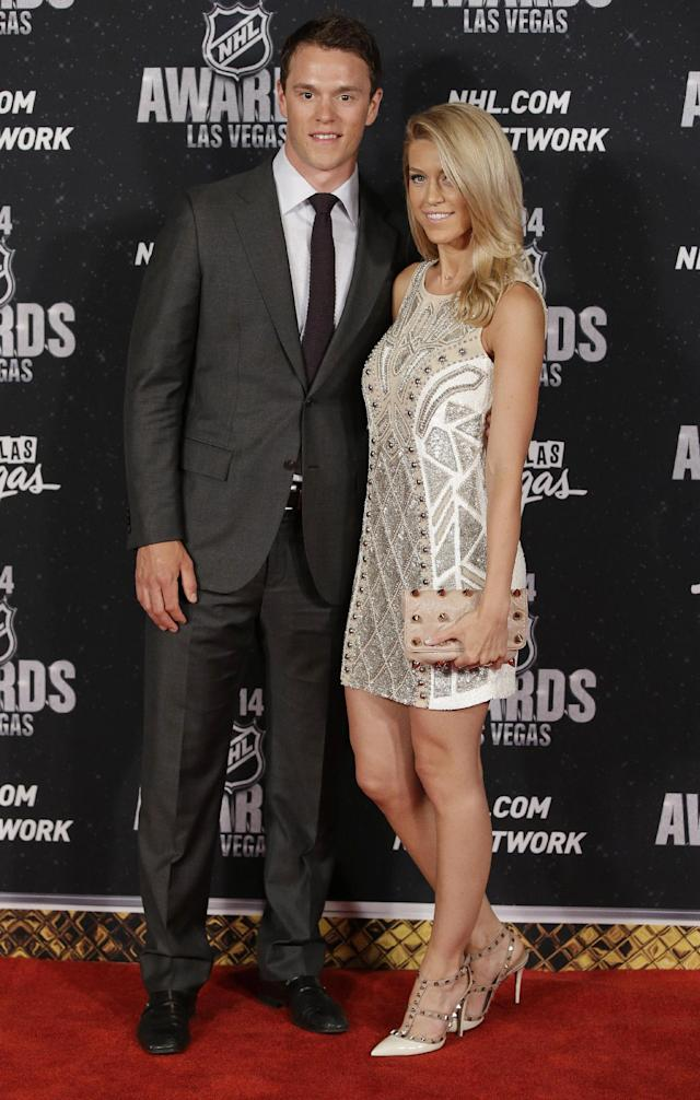 Jonathan Toews of the Chicago Blackhawks poses with his girlfriend, Lindsey Vecchione, on the red carpet before the NHL Awards on Tuesday, June 24, 2014, in Las Vegas. (AP Photo/John Locher)