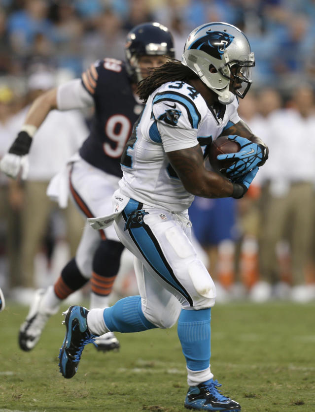 Carolina Panthers running back DeAngelo Williams (34) carries the ball as Chicago Bears defensive end Shea McClellin (99) pursues during the first half of a preseason NFL football game in Charlotte, N.C., Friday, Aug. 9, 2013. (AP Photo/Chuck Burton)