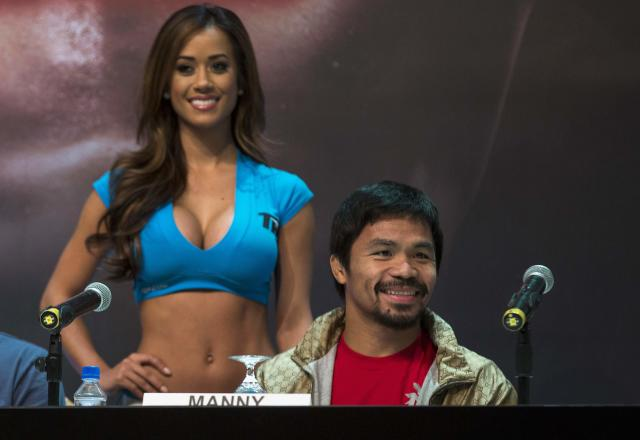 Filipino boxer Manny Pacquiao attends a news conference at the Venetian Macao hotel in Macau November 20, 2013. Pacquiao will fight against American Brandon Rios in a 12-round welterweight clash on November 24. REUTERS/Tyrone Siu (CHINA - Tags: SPORT BOXING)