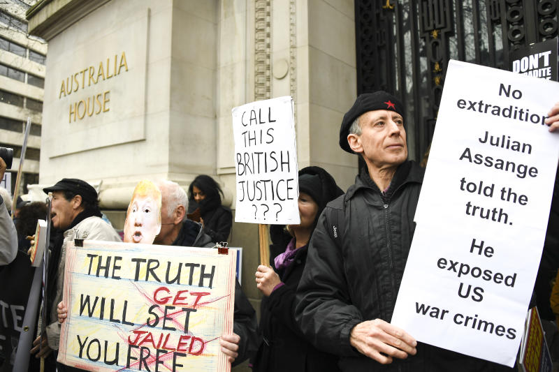 Demonstrators gather outside Australia House to protest against the extradition of Wikileaks founder Julian Assange, in London, Saturday, Feb. 22, 2020. Assange is fighting extradition to the United States on spying charges. (AP Photo/Alberto Pezzali)