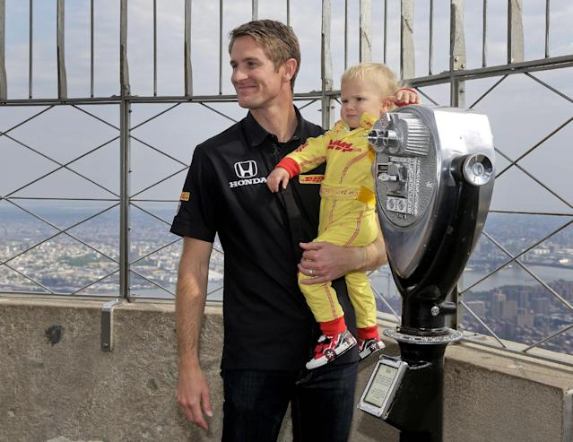 Indianapolis 500 winner Ryan Hunter-Reay poses for photos with his son, Ryden, on top of the Empire State Building, Tuesday, May 27, 2014, in New York. Hunter-Reay defeated three-time Indy winner Helio Castroneves on Sunday, and is the first American to win the event since 2006. (AP Photo/Julie Jacobson)
