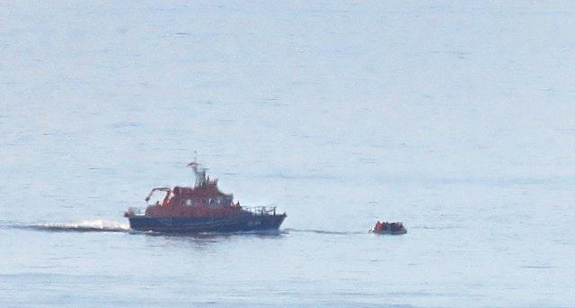 A lifeboat approaches a small craft thought to be carrying migrants off the Kent coast near Dover