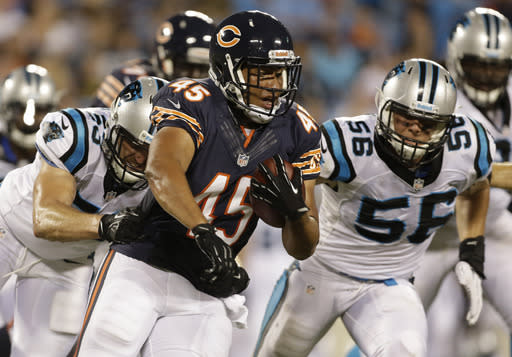Chicago Bears' Harvey Unga (45) runs as Carolina Panthers' A.J. Klein (56) and Ben Jacobs (53) defend during the second half of a preseason NFL football game in Charlotte, N.C., Friday, Aug. 9, 2013. (AP Photo/Bob Leverone)
