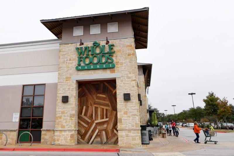 Customers are seen outside a Whole Foods Market in Austin