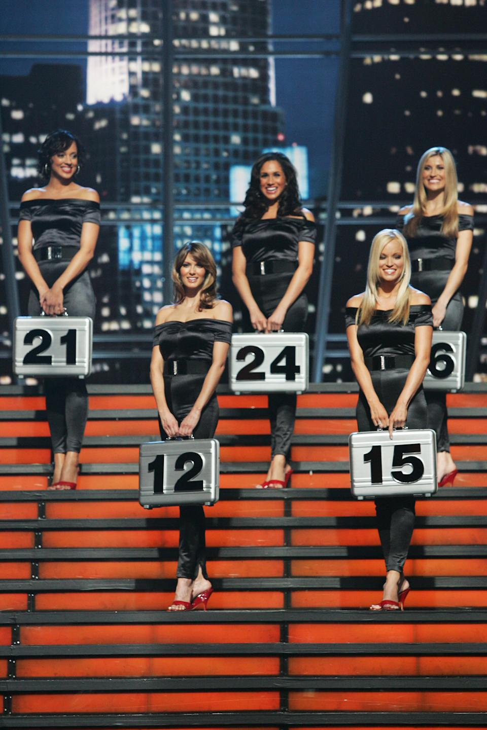 DEAL OR NO DEAL -- Episode 241 -- Pictured: (l-r, number order) Jill Manas (12), Brooke Long (15), Tameka Jacobs (21), Meghan Markle (24), Lindsay Clubine (26) -- (Photo by: Trae Patton/NBCU Photo Bank/NBCUniversal via Getty Images via Getty Images)
