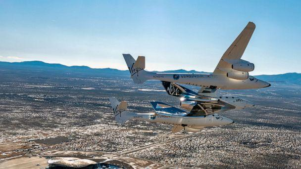 PHOTO: This Feb. 13, 2020, file photo shows the Virgin Galactic's VSS Unity flying over Spaceport America in Truth or Consequences, N.M. (Virgin Galactic via AP, FILE)