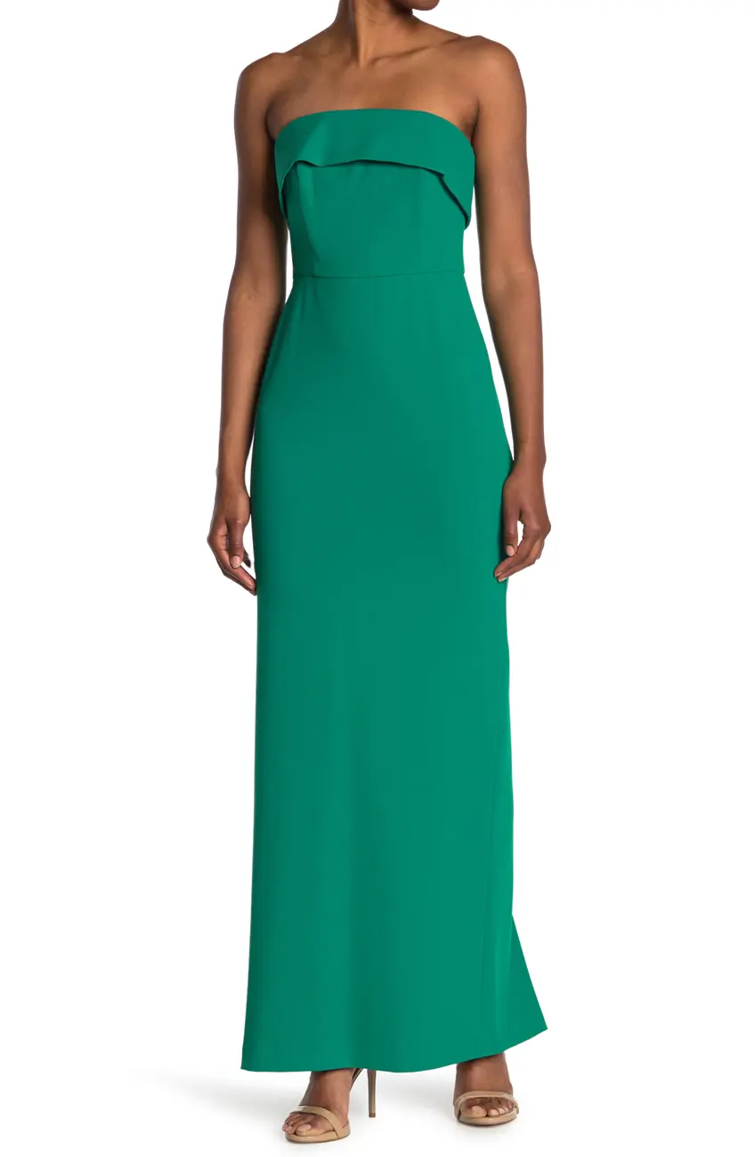 """<h3><strong>Nordstrom Rack</strong></h3><br><strong>Price Range:</strong> $24 - $400<br><strong>Size Range:</strong> XXS - 3X<br><br>With a host of wallet-friendly formal dress labels like <a href=""""https://www.nordstromrack.com/shop/search?query=nsr&division=Women&department=Clothing&class=Dresses"""" rel=""""nofollow noopener"""" target=""""_blank"""" data-ylk=""""slk:NSR"""" class=""""link rapid-noclick-resp"""">NSR</a>, <a href=""""https://www.nordstromrack.com/shop/search?query=marina&division=Women&department=Clothing&class=Dresses"""" rel=""""nofollow noopener"""" target=""""_blank"""" data-ylk=""""slk:Marina"""" class=""""link rapid-noclick-resp"""">Marina</a>, <a href=""""https://www.nordstromrack.com/shop/search?query=dress%20the%20population&division=Women&department=Clothing&class=Dresses"""" rel=""""nofollow noopener"""" target=""""_blank"""" data-ylk=""""slk:Dress the Population"""" class=""""link rapid-noclick-resp"""">Dress the Population</a>, and <a href=""""https://www.nordstromrack.com/shop/search?query=bardot&division=Women&department=Clothing&class=Dresses"""" rel=""""nofollow noopener"""" target=""""_blank"""" data-ylk=""""slk:Bardot"""" class=""""link rapid-noclick-resp"""">Bardot</a>, Nordstrom Rack offers an amazing array of styles with the type of customer service that we've come to expect from Nordy. There's also an excellent chance of being able to re-wear one of these dresses for non-bridal party purposes.<br><br><em>Shop <strong><a href=""""https://www.nordstromrack.com/shop/Women/Clothing/Dresses"""" rel=""""nofollow noopener"""" target=""""_blank"""" data-ylk=""""slk:Nordstrom Rack"""" class=""""link rapid-noclick-resp"""">Nordstrom Rack</a></strong></em><br><br><strong>Calvin Klein</strong> Strapless Foldover Gown, $, available at <a href=""""https://go.skimresources.com/?id=30283X879131&url=https%3A%2F%2Fwww.nordstromrack.com%2Fs%2Fcalvin-klein-strapless-foldover-gown%2Fn3591563"""" rel=""""nofollow noopener"""" target=""""_blank"""" data-ylk=""""slk:Nordstrom Rack"""" class=""""link rapid-noclick-resp"""">Nordstrom Rack</a>"""