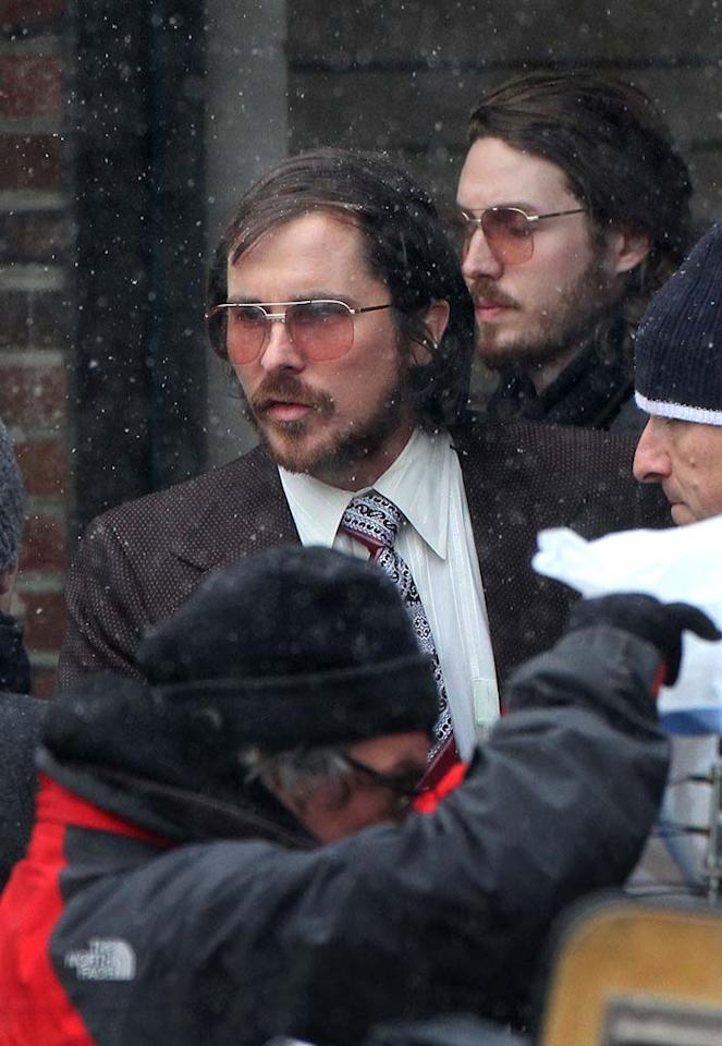 "Batman, is that you? Christian Bale sported a hairy face, retro shades, and a combover hairstyle on the Natick, Massachusetts, set of his new movie. The untitled project from ""The Fighter"" and ""Silver Linings Playbook"" director David O. Russell depicts the 1970's FBI sting operation known as Abscam. (3/21/2013)"