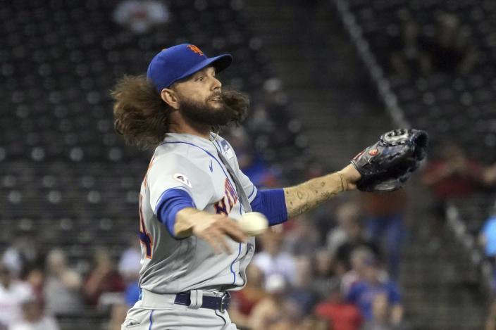 New York Mets pitcher Robert Gsellman makes the play for an out on a ball hit by Arizona Diamondbacks' Ildemaro Vargas in the third inning during a baseball game, Wednesday, June 2, 2021, in Phoenix. (AP Photo/Rick Scuteri)