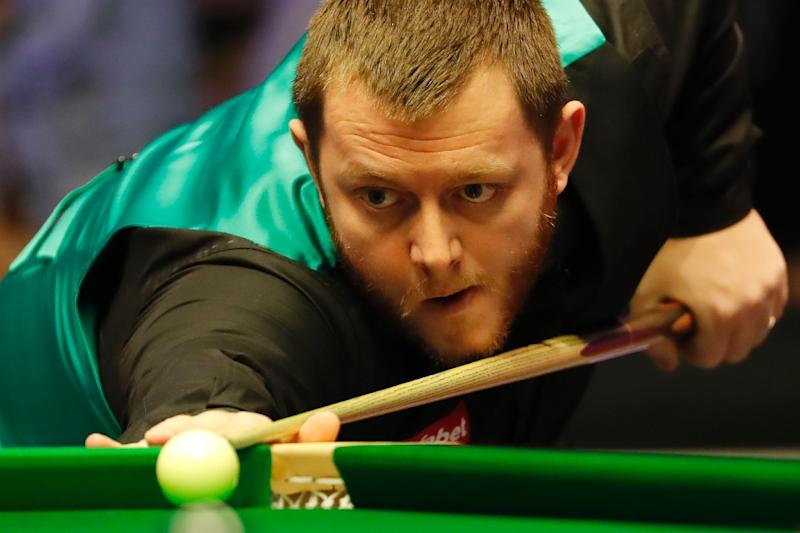 China's Zhou Yuelong claimed a notable scalp in sixth seeded Mark Allen to reach the second round of the snooker world championships