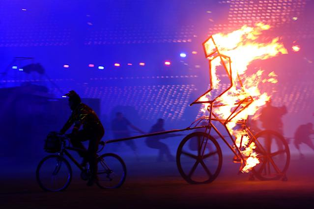 LONDON, ENGLAND - SEPTEMBER 09: A flaming figure of a cyclist enters the arena during the closing ceremony on day 11 of the London 2012 Paralympic Games at Olympic Stadium on September 9, 2012 in London, England. (Photo by Peter Macdiarmid/Getty Images)