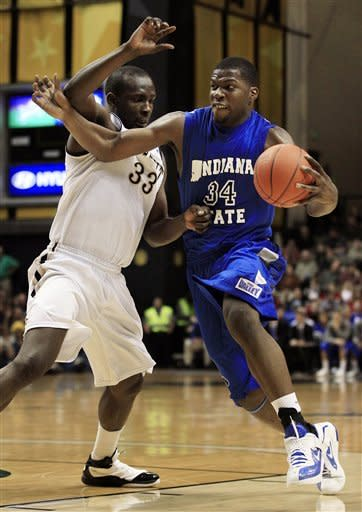 Indiana State center Myles Walker (34) drives against Vanderbilt forward Steve Tchiengang (33) in the first half of an NCAA college basketball game on Saturday, Dec. 17, 2011, in Nashville, Tenn. (AP Photo/Mark Humphrey)
