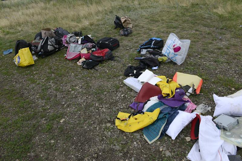 Passengers' belongings lie at the site where the Malaysia Airlines plane crashed in Grabove, east Ukraine, on July 19, 2014