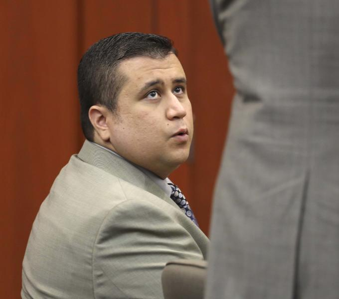 George Zimmerman talks to his attorney, Mark O'Mara, in Seminole circuit court, in Sanford, Fla., Thursday, June 6, 2013. A judge denied a defense request to let a handful of witnesses testify confidentialiy during Zimmerman's trial for fatally shooting Trayvon Martin. Zimmerman is pleading not guilty, claiming self-defense. (AP Photo/Orlando Sentinel, Joe Burbank, Pool)