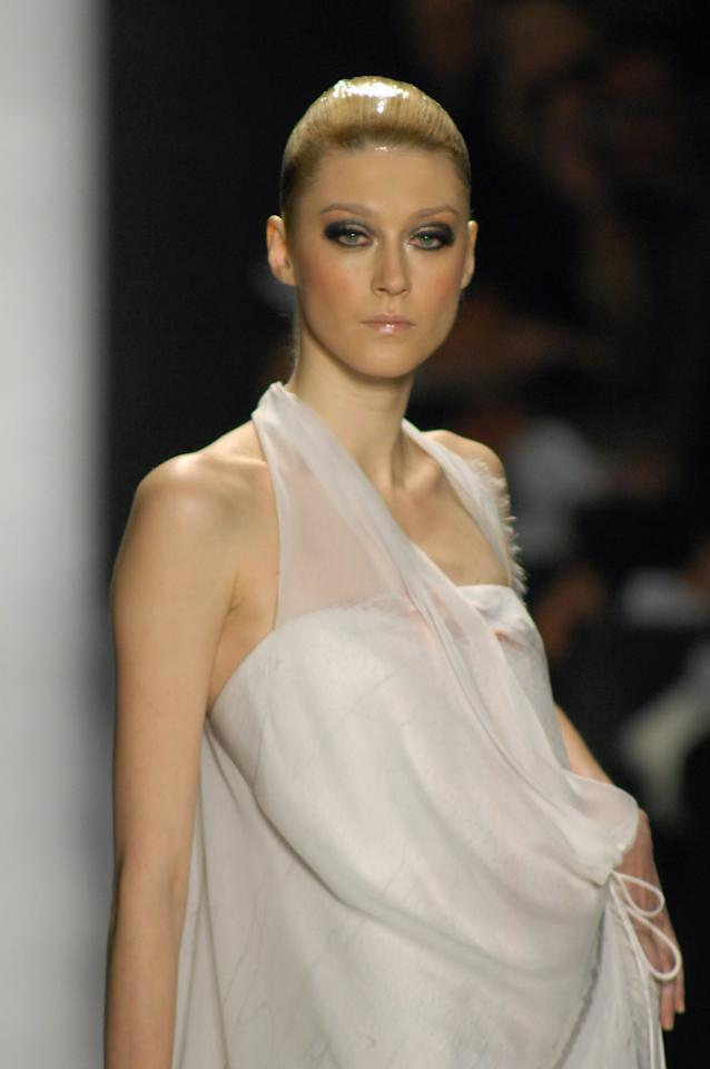 Anastassia Khozzisova wearing Chado Ralph Rucci Haute Couture Spring 2007 (Photo by Carlo Buscemi/WireImage)