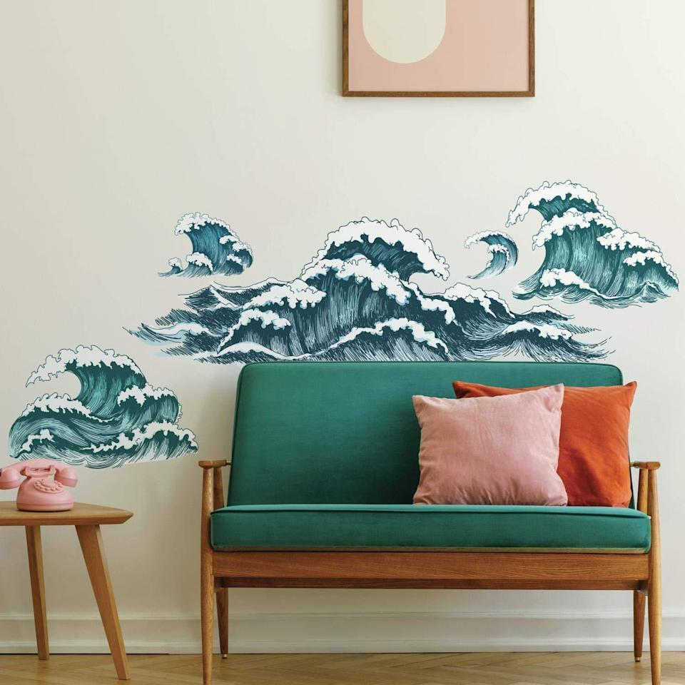 """<h2>RoomMates Great Wave Peel & Stick Wall Decals</h2><br>""""Another shopping bender took place on Amazon, where I ordered a host of aquatically-themed decor for my daughter's Aquarian first birthday. (Yes, I know it's technically an air sign, but the sign's symbol is the water bearer so we decided to go with the latter.) Since we couldn't have an actual party this year, I figured I might out as well go all out with decorations, to make our micro-celebration feel as festive as possible. I won't bore you with the details of everything I purchased, but one thing that I do recommend for anyone with walls are these ginormous peel 'n' stick decals. We ordered these illustrated ocean waves, but pretty much every design under the sun is available to stick on your wall. For adults, I recommend the <a href=""""https://amzn.to/3rtDnoZ"""" rel=""""nofollow noopener"""" target=""""_blank"""" data-ylk=""""slk:giant cactus"""" class=""""link rapid-noclick-resp"""">giant cactus</a>, <a href=""""https://amzn.to/2LjLy7I"""" rel=""""nofollow noopener"""" target=""""_blank"""" data-ylk=""""slk:faux ivy"""" class=""""link rapid-noclick-resp"""">faux ivy</a>, or maybe the <a href=""""https://amzn.to/39Om1wU"""" rel=""""nofollow noopener"""" target=""""_blank"""" data-ylk=""""slk:dry erase calendar"""" class=""""link rapid-noclick-resp"""">dry erase calendar</a> for chic-ifying (and streamlining) your WFH setup. We took them on and off the walls all weekend and I promise they left no trace at all. Could be a great solution for anyone who wants to refresh their walls but doesn't have the wherewithal to paint (me)."""" <em>– Emily Ruane, Fashion Writer</em><br><br><em>Shop <strong><a href=""""https://amzn.to/3pTxtwP"""" rel=""""nofollow noopener"""" target=""""_blank"""" data-ylk=""""slk:Amazon"""" class=""""link rapid-noclick-resp"""">Amazon</a></strong></em><br><br><strong>RoomMates</strong> Great Wave Peel And Stick Giant Wall Decals, $, available at <a href=""""https://amzn.to/39PZy2u"""" rel=""""nofollow noopener"""" target=""""_blank"""" data-ylk=""""slk:Amazon"""" class=""""link rapid-noclick-resp"""">Amazon</a>"""
