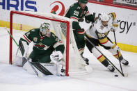 Vegas Golden Knights right wing Keegan Kolesar (55) brings the puck around the goal as Minnesota Wild's Ryan Suter (20) and goaltender Cam Talbot (33) defend during the first period of an NHL hockey game, Wednesday, May 5, 2021, in St. Paul, Minn. (AP Photo/Andy Clayton-King)