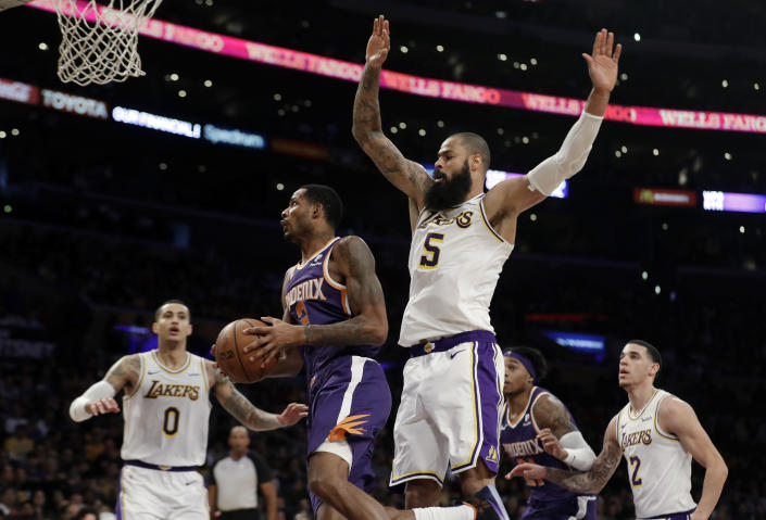 Phoenix Suns' Trevor Ariza, second from left, drives past Los Angeles Lakers' Tyson Chandler (5) during the first half of an NBA basketball game Sunday, Dec. 2, 2018, in Los Angeles. (AP Photo/Marcio Jose Sanchez)