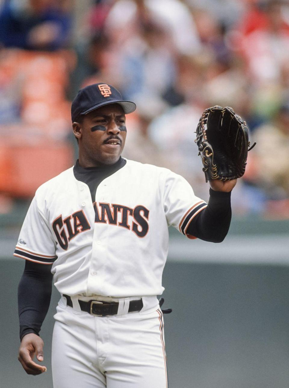 """<p><strong>April 26, 1989</strong>: Kevin Mitchell was a talented baseball player with a gift for the unexpected. It all came together for """"Mitch"""" in 1989, when he was named National League MVP—and made one of the wildest catches in baseball history.<br><br>Here's the scene: Mitchell's in left field at Busch Stadium when the Cardinals' Ozzie Smith hits a tailing fly ball toward the left-field line. Mitchell runs hard—too hard, in fact. He overruns the fly ball, realizes it, and reaches back with his right hand—the one without a glove—to make a crazy, over-the-head catch.<br><br>Mitchell's explanation: """"I was running as hard as I could, and it just came back on me. All I could do was stick up my hand and there it was.""""<br> </p>"""