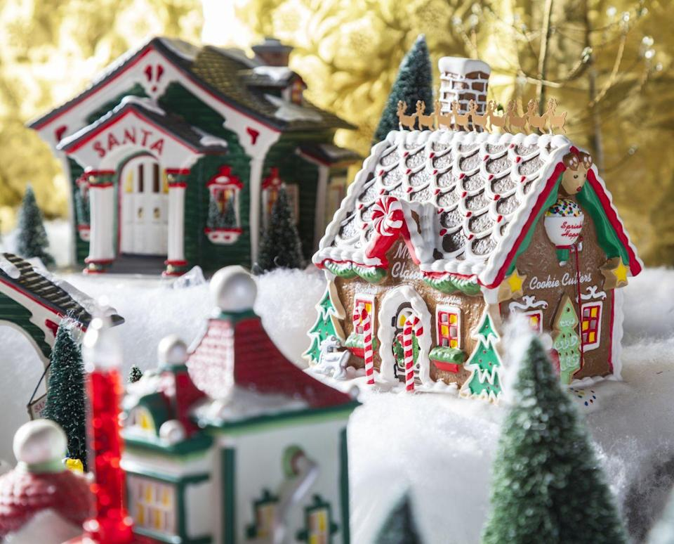 """<p>Even if you don't have an extensive collection of ceramic houses and figurines, you can still reserve an afternoon to assemble a little Christmas village. Paint wooden houses from the craft store (or make your own from craft sticks!), then set the scene with faux snow and other little baubles. </p><p><em>Learn how to make a colorful Christmas village at <a href=""""https://studiodiy.com/diy-colorful-christmas-village/"""" rel=""""nofollow noopener"""" target=""""_blank"""" data-ylk=""""slk:Studio DIY"""" class=""""link rapid-noclick-resp"""">Studio DIY</a>.</em></p><p><a class=""""link rapid-noclick-resp"""" href=""""https://www.amazon.com/Woodpile-Fun-Cabin-Unfinished-Birdhouse/dp/B0868XBF51/?tag=syn-yahoo-20&ascsubtag=%5Bartid%7C10072.g.34454588%5Bsrc%7Cyahoo-us"""" rel=""""nofollow noopener"""" target=""""_blank"""" data-ylk=""""slk:SHOP WOODEN HOUSE"""">SHOP WOODEN HOUSE</a><br></p>"""