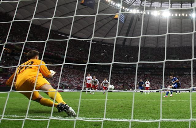 WARSAW, POLAND - JUNE 08: Przemyslaw Tyton of Poland saves Giorgos Karagounis of Greece's penalty during the UEFA EURO 2012 group A match between Poland and Greece at The National Stadium on June 8, 2012 in Warsaw, Poland. (Photo by Michael Steele/Getty Images)