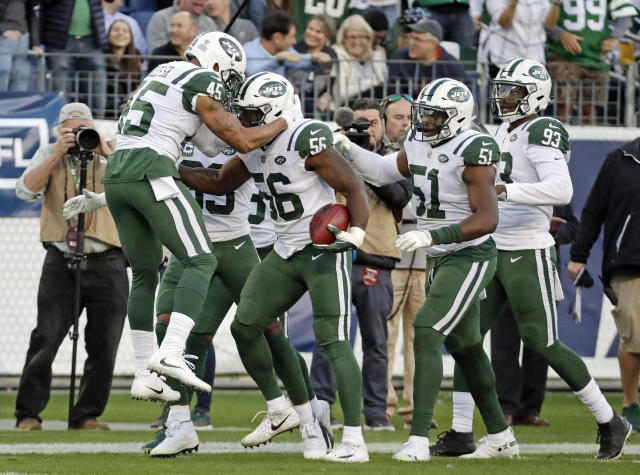 New York Jets linebacker Kevin Pierre-Louis (56) celebrates with teammates after blocking a punt by the Tennessee Titans and recovering the ball in the first half of an NFL football game Sunday, Dec. 2, 2018, in Nashville, Tenn. (AP Photo/James Kenney)