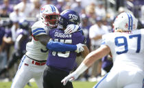 TCU quarterback Max Duggan (15) is sacked by SMU defensive end Delontae Scott (35) during the first half of an NCAA college football game Saturday, Sept. 21, 2019, in Fort Worth, Texas. (AP Photo/Ron Jenkins)