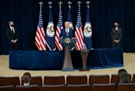 US President Joe Biden, with Secretary of State Antony Blinken and Vice President Kamala Harris, speaks to the staff of the US State Department