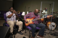 Musicians play their instruments during a church service at the New Horizon International Church, Sunday, Oct. 4, 2020, in Jackson, Miss. The virus ripped through Mississippi's Black community early in the pandemic. About 60% of infections and deaths were among African Americans, who make up 38% of the state's population. (AP Photo/Wong Maye-E)