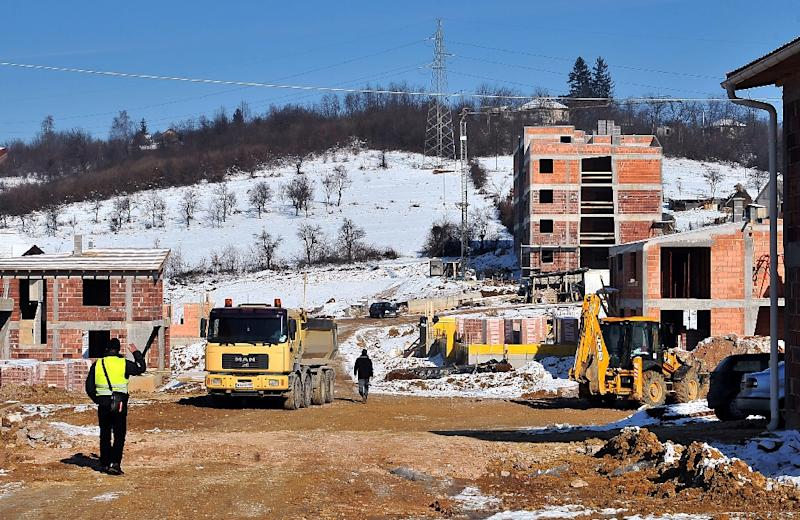 A picture taken on January 19, 2016 shows several houses under construction in Sarajevo's suburban area of Blazuj (AFP Photo/Elvis Barukcic)