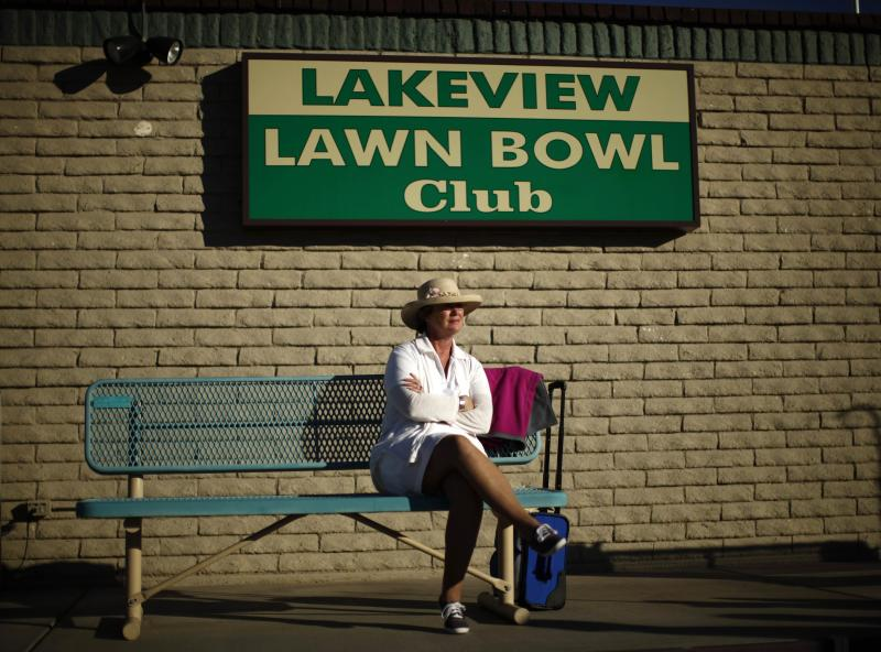 Carol McGregor, 59, of Smithers, BC in Canada, watches lawn bowls in Sun City, Arizona, January 5, 2013. Sun City was built in 1959 by entrepreneur Del Webb as America's first active retirement community for the over-55's. Del Webb predicted that retirees would flock to a community where they were given more than just a house with a rocking chair in which to sit and wait to die. Today's residents keep their minds and bodies active by socializing at over 120 clubs with activities such as square dancing, ceramics, roller skating, computers, cheerleading, racquetball and yoga. There are 38,500 residents in the community with an average age 72.4 years. Picture taken January 5, 2013. REUTERS/Lucy Nicholson (UNITED STATES - Tags: SOCIETY) ATTENTION EDITORS - PICTURE 11 OF 30 FOR PACKAGE 'THE SPORTY SENIORS OF SUN CITY' SEARCH 'SUN CITY' FOR ALL IMAGES