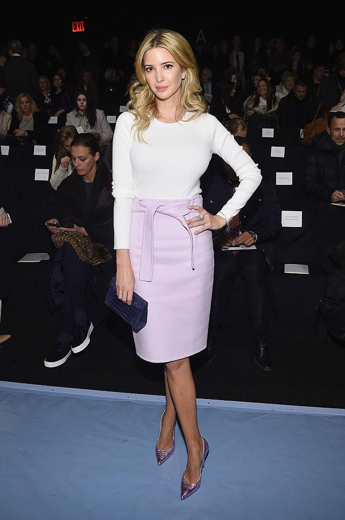 Ivanka Trump in a lilac skirt and white long sleeve shirt on February 10, 2014 in the front row at Carolina Herrera's fashion show. (Photo: Larry Busacca/Getty Images for Mercedes-Benz Fashion Week)