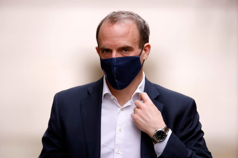 FILE PHOTO: Britain's Foreign Affairs Secretary Dominic Raab walks outside Downing Street in London