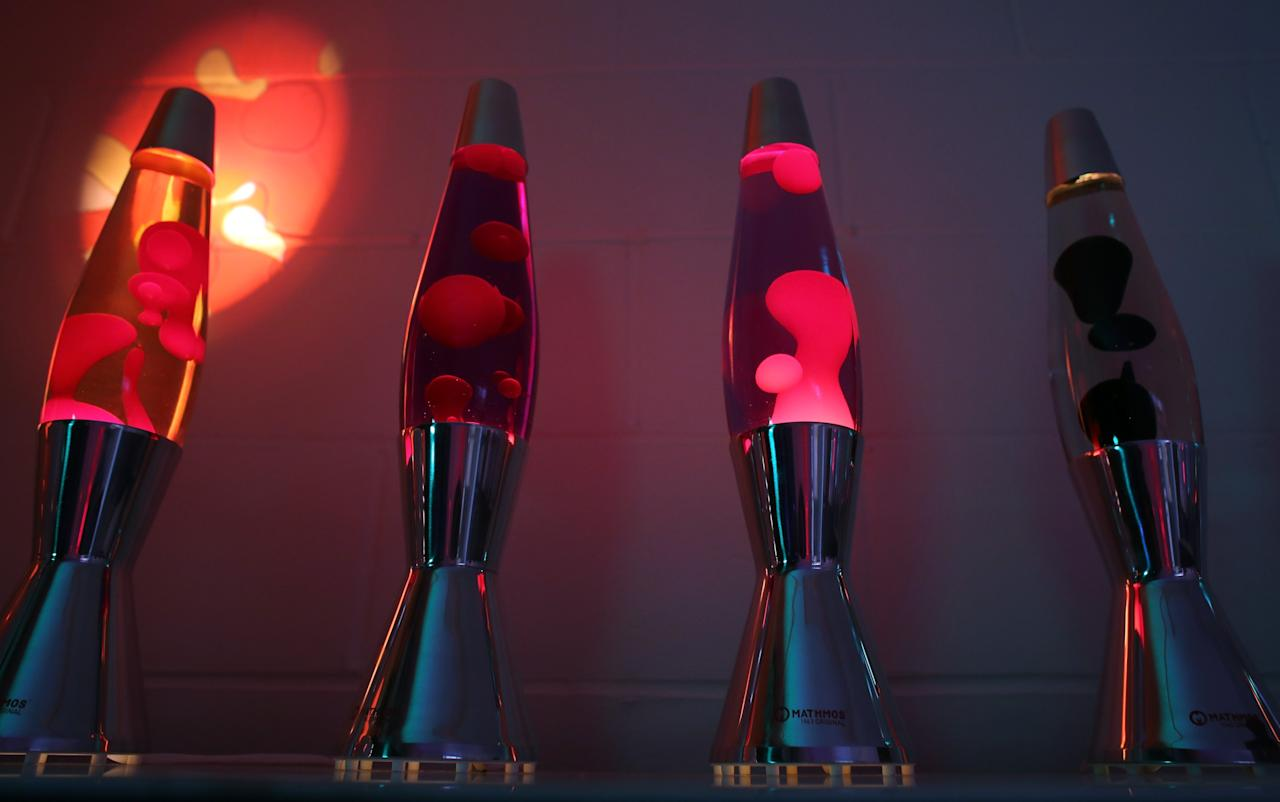 POOLE, ENGLAND - SEPTEMBER 12: Finished lava lamps are shown on display at the Mathmos factory on September 12, 2013 in Poole, England. The company, based in Poole, Dorset, has been making the lava lamp since 1963, after it's British inventor Edward Craven-Walker was inspired to make it after seeing an odd looking liquid-filled egg timer in a pub. (Photo by Matt Cardy/Getty Images)