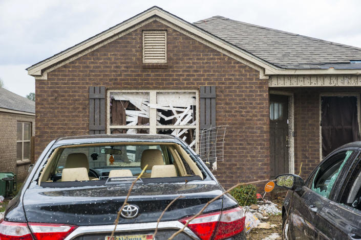 Homes and cars on Waterbury Drive were heavily damaged from severe weather, Wednesday, March 17, 2021, in Moundville, Ala. Possible tornadoes knocked down trees, toppled power lines and damaged homes in rural Chilton County and the Alabama communities of Burnsville and Moundville, where power was out and trees blocked a main highway. (AP Photo/Vasha Hunt)