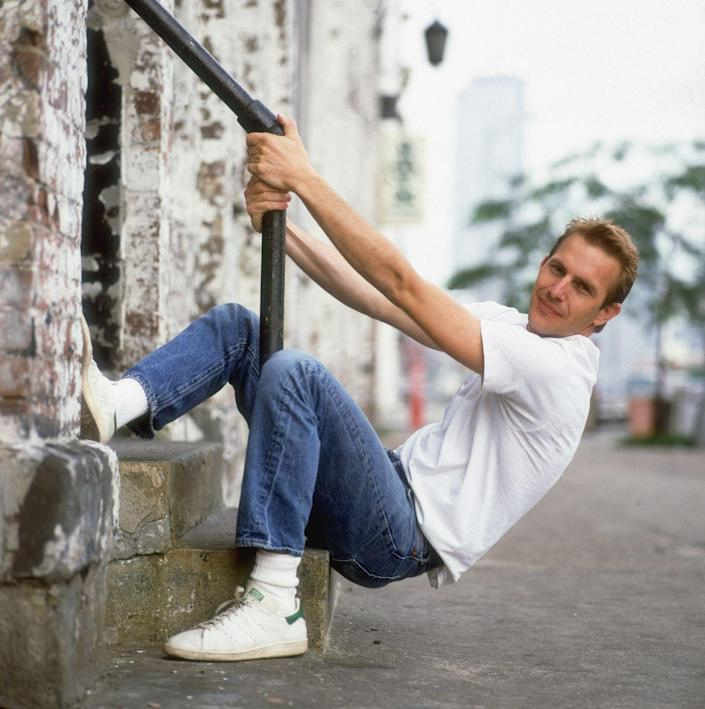 <p>Kevin Costner in 1990 doing what—we don't know. But check out those sneakers. </p>
