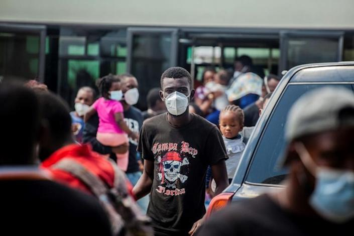 An expelled migrant arrives at the airport in Port-au-Prince on Sunday (AFP/Richard Pierrin)