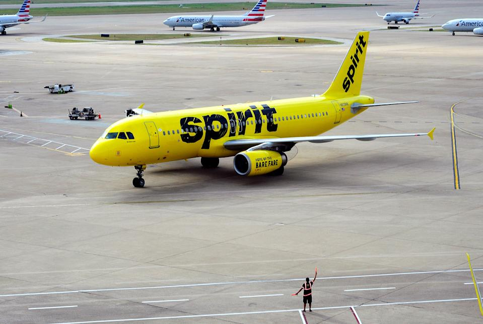 DALLAS, TX - SEPTEMBER 21, 2017:  A Spirit Airlines Airbus A320 passenger jet taxis at the Dallas/Fort Worth International Airport, located roughly halfway between Dallas and Fort Worth, Texas. (Photo by Robert Alexander/Getty Images)