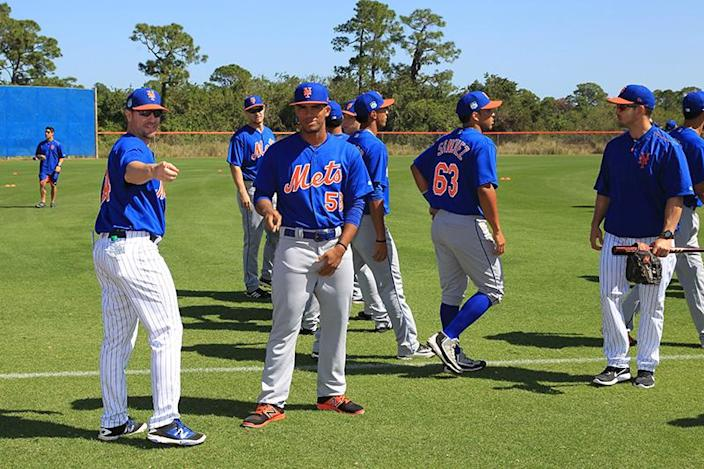<p>New York Mets coaches and prospects gather on the field before workouts at the New York Mets spring training facility in Port St. Lucie, Fla., Sunday, Feb. 26, 2017. (Gordon Donovan/Yahoo Sports) </p>