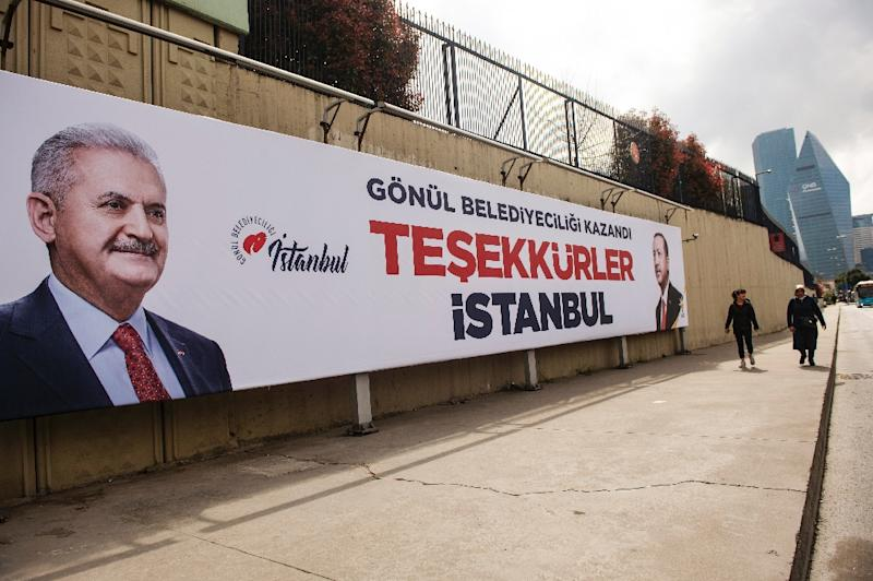 """The ruling AKP party had already put up banners in the city saying """"Thank You Istanbul"""" portraying candidate Binali Yildirim and Erdogan (AFP Photo/Yasin AKGUL)"""