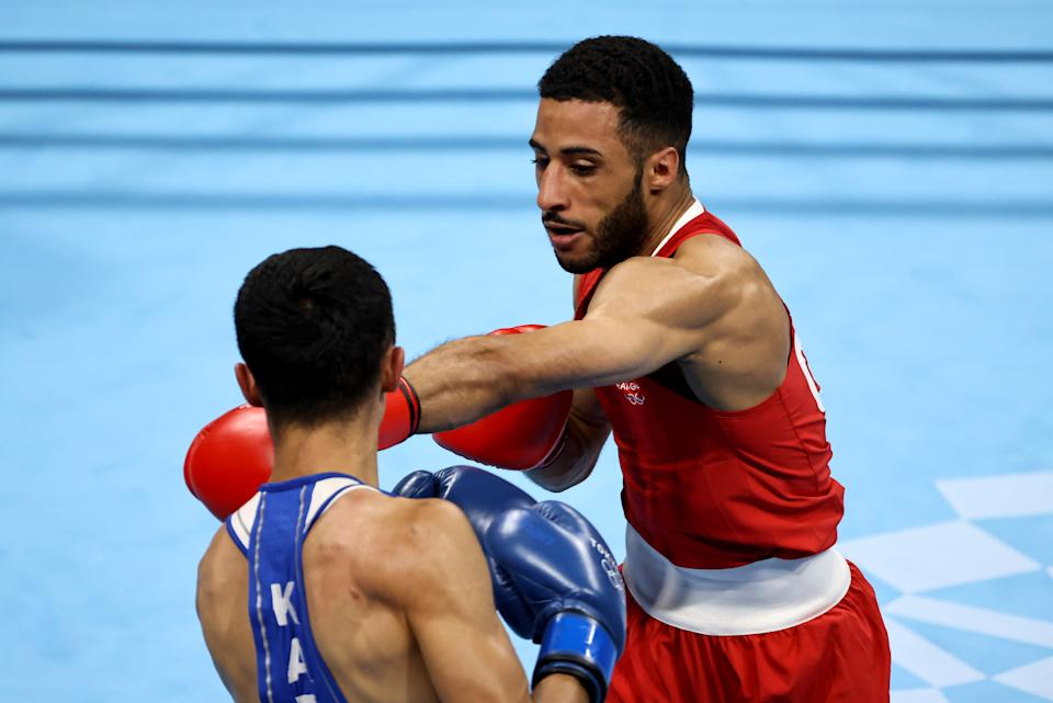TOKYO, JAPAN - AUGUST 05: Galal Yafai (red) of Team Great Britain exchanges punches with Saken Bibossinov of Team Kazakhstan during the Men's Fly (48-52kg) semi final on day thirteen of the Tokyo 2020 Olympic Games at Kokugikan Arena on August 05, 2021 in Tokyo, Japan. (Photo by Buda Mendes/Getty Images)