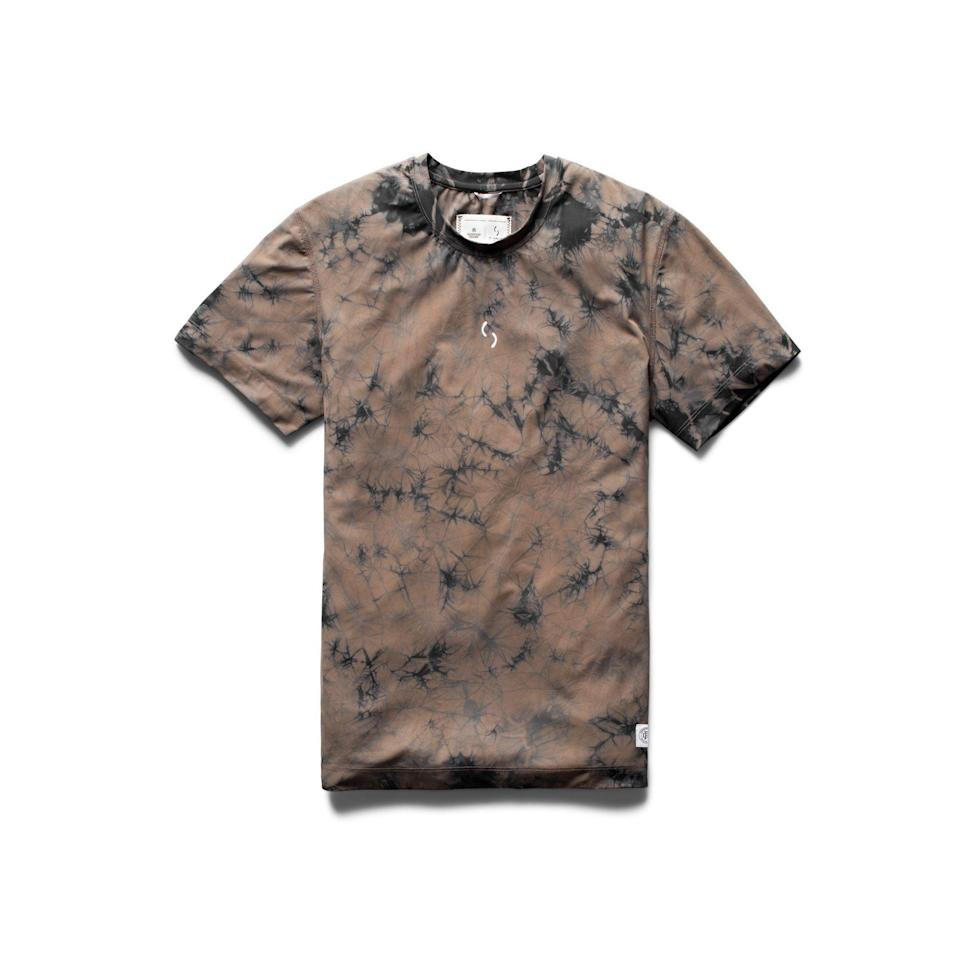 """<p><strong>Reigning Champ x Ryan Willms</strong></p><p>reigningchamp.com</p><p><strong>$125.00</strong></p><p><a href=""""https://shop.reigningchamp.com/collections/ryan-willms/products/ryan-willms-tie-dye-t-shirt-shore"""" rel=""""nofollow noopener"""" target=""""_blank"""" data-ylk=""""slk:Shop Now"""" class=""""link rapid-noclick-resp"""">Shop Now</a></p><p>On first glance, it's a tie-dye tee in an earthy, toned-down color palette that brings the pattern into the 21st century. But it's even better than that, because it's also a true performance piece made from Italian stretch nylon. Perfect for your daily run—and whatever comes after. </p>"""