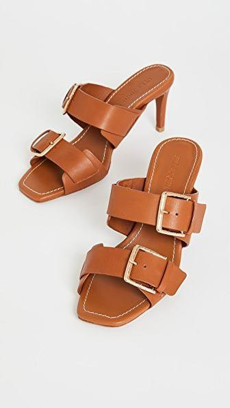 """<p><strong>Ulla Johnson</strong></p><p>shopbop.com</p><p><strong>$475.00</strong></p><p><a href=""""https://go.redirectingat.com?id=74968X1596630&url=https%3A%2F%2Fwww.shopbop.com%2Fcarine-heel-sandal-ulla-johnson%2Fvp%2Fv%3D1%2F1537764808.htm&sref=https%3A%2F%2Fwww.townandcountrymag.com%2Fstyle%2Ffashion-trends%2Fg36384322%2Fbest-sandals-for-women%2F"""" rel=""""nofollow noopener"""" target=""""_blank"""" data-ylk=""""slk:Shop Now"""" class=""""link rapid-noclick-resp"""">Shop Now</a></p><p>Mega-sized buckles and cognac leather give these sandals a cool '90s effect that's very in right now. </p>"""