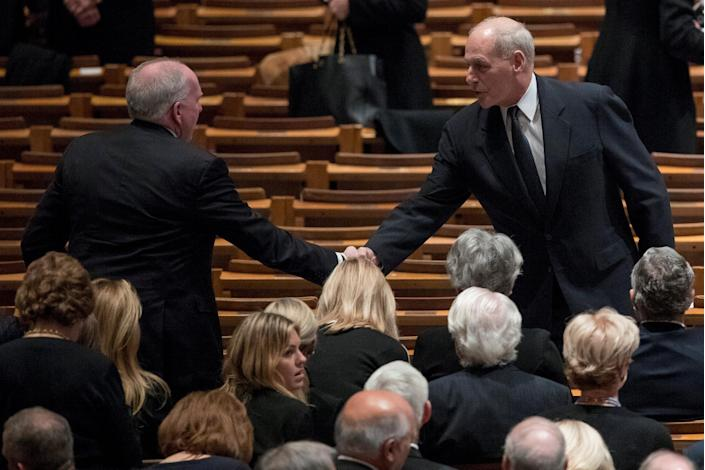 Former CIA Director John Brennan shakes hands with President Donald Trump's Chief of Staff John Kelly before a State Funeral for former President George H.W. Bush at the National Cathedral, Wednesday, Dec. 5, 2018, in Washington. (Photo: Andrew Harnik/Pool via Reuters)
