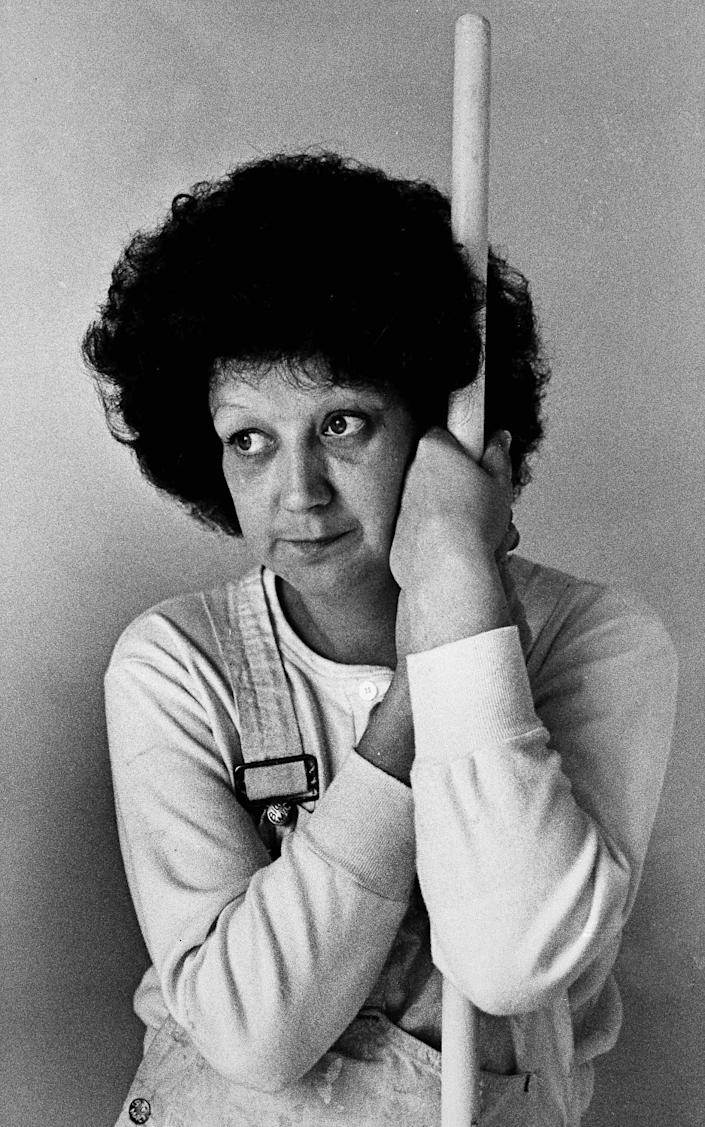 """Norma McCorvey, 35, the Dallas mother whose desire to have an abortion was the basis for a landmark Supreme Court decision a decade ago, takes time from her job as a house painter to pose for a photograph in Terrell, Texas, on Thursday, Jan. 21, 1983. To legal scholars, she is simply """"Jane Roe."""" <span class=""""copyright"""">(Bill Janscha / Associated Press)</span>"""