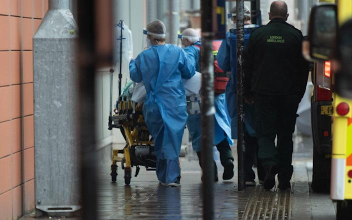 A Covid patient is unloaded from an ambulance and taken into Royal London Hospital in Whitechapel, London - Justin Ng/Avalon