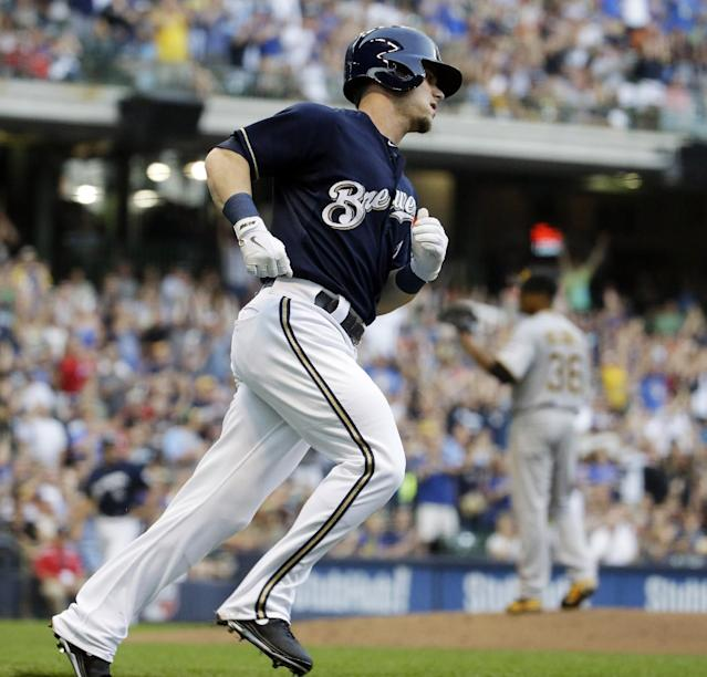 Milwaukee Brewers' Scooter Gennett rounds the bases after hitting a home run during the second inning of a baseball game against the Pittsburgh Pirates on Saturday, Aug. 23, 2014, in Milwaukee. (AP Photo/Morry Gash)