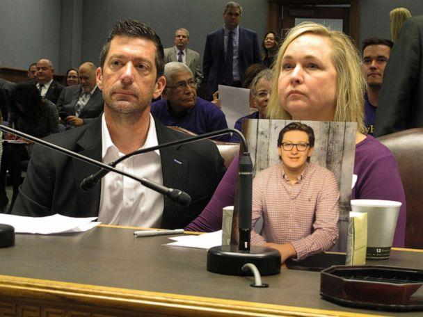 PHOTO: Stephen and Rae Ann Gruver sit in a House committee room behind a photo of their son, 18-year-old Maxwell Gruver, who died in what authorities say was a hazing incident, March 21, 2018, in Baton Rouge, La. (Melinda Deslatte/AP, FILE)