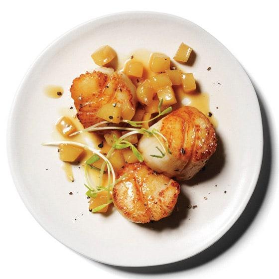 """Sweet and tart Granny Smith apples are the perfect complement to buttery, rich scallops. <a href=""""https://www.epicurious.com/recipes/food/views/scallops-with-apple-pan-sauce-51160700?mbid=synd_yahoo_rss"""" rel=""""nofollow noopener"""" target=""""_blank"""" data-ylk=""""slk:See recipe."""" class=""""link rapid-noclick-resp"""">See recipe.</a>"""