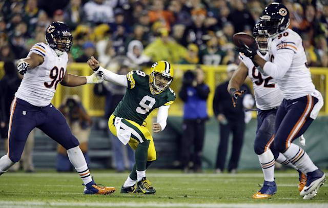 Green Bay Packers quarterback Seneca Wallace watches as Chicago Bears' Julius Peppers (90) intercepts a pass during the first half of an NFL football game Monday, Nov. 4, 2013, in Green Bay, Wis. (AP Photo/Jeffrey Phelps)
